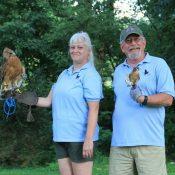 Regina Wolfe with resident Red Shouldered Hawk Cinnamon & Charlie Carper with resident American Kestrel Skylar