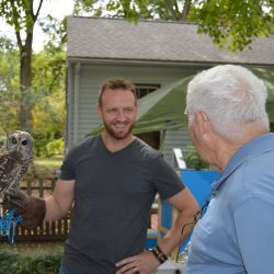 Andy Norvell with resident Barred Owl Luna at a private event