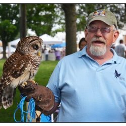 Charlie Carper with resident Barred Owl Luna at the Franklin Street Bazaar